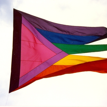 Pride flag at Seattle's 1988 Gay Pride Parade. [Series 1825, History files, Seattle-King County Department of Public Health: Prevention Division / HIV-AIDS Program. 1825-10-2.]
