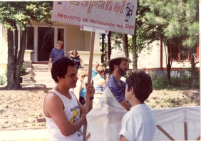 AIDS Prevention Project staff Javier Amaya (holding sign) and David Bibus with AIDS Prevention Project float advertising the Be a Star study at Seattle's 1989 Gay Pride Parade. [Series 1825, History files, Seattle-King County Department of Public Health: Prevention Division / HIV-AIDS Program. 1825-10-3.]