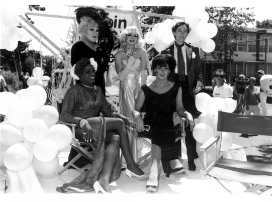 "AIDS Prevention Project volunteers playing the ""stars"" (Billie Holiday, Mae West, Marilyn Monroe, Judy Garland, and Oscar Wilde) on float advertising the Be a Star study at Seattle's 1987 Gay Pride Parade. [Series 1825, History files, Seattle-King County Department of Public Health: Prevention Division / HIV-AIDS Program. 1825-2-13.]"